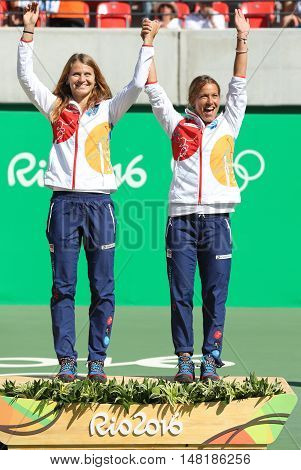RIO DE JANEIRO, BRAZIL - AUGUST 14, 2016: Bronze medalists team Czech Lucie Safarova (L) and Barbora Strycova during medal ceremony after tennis women's doubles final of the Rio 2016 Olympic Games