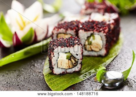 Maki Sushi - Roll made of Cream Cheese, Tamago, Cucumber and Smoked Eel inside. Red and Black Tobiko outside
