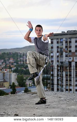 young man jumping in air outdoor at night ready for party