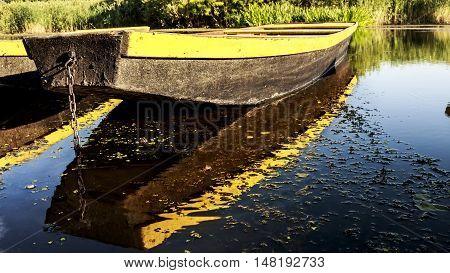 Boat anchored at the lakes shore at natural reserve