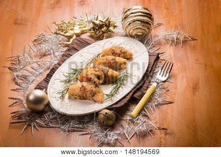 stuffed rolled up over christmas table