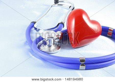 Medical Instruments, Stethoscope And Red Heart Closeup Shot