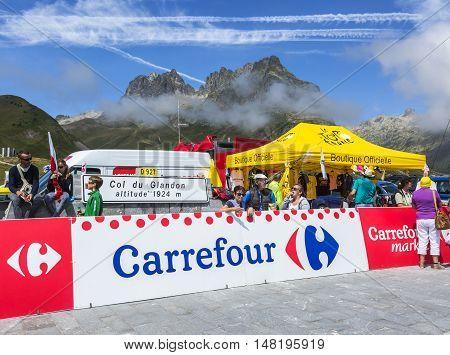 Col du Glandon France - July 23 2015: Image of unidentified fans near the Tour de France Official Shop located on Col du Glandon in Alps during the stage 18 of Le Tour de France 2015.