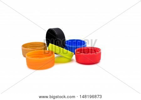 Colorful plastic bottle caps isolated on white background.