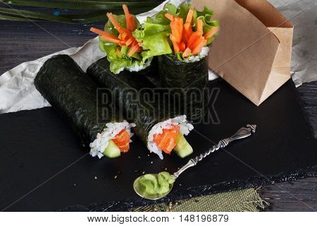 roll sushi black background different tastes crab carrots lettuce tofu salmon still life home stylish wooden worktops table