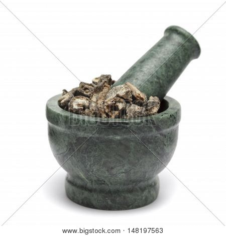 Organic Dried gooseberry or Amla (Ribes grossularia) on marble pestle. Isolated on white background.