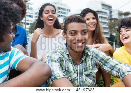 Multiethnic group of young adults outdoor in a park in the summer