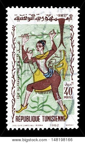 TUNISIA - CIRCA 1962 : Cancelled postage stamp printed by Tunisia, that shows Woman dancing.