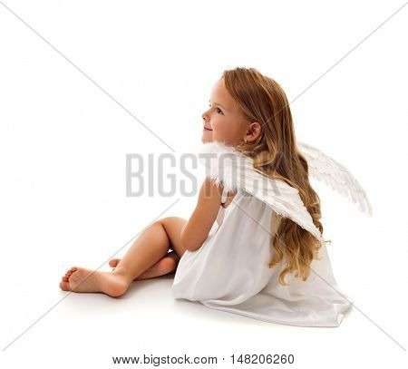 Little angel sitting - cute girl with long hair and white wings