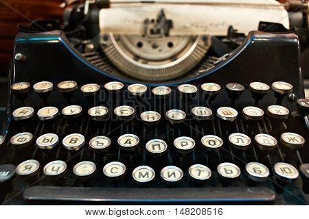 The old black retro typewriter a closeup