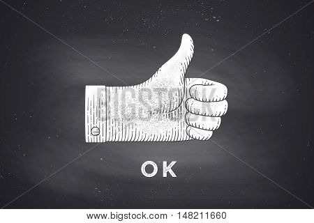 Vintage drawing of hand sign giving ok or thumbs up in engraving retro style, drawing on chalkboard with text OK. Old drawn thumbs up for sign, information sign and navigation. Vector Illustration