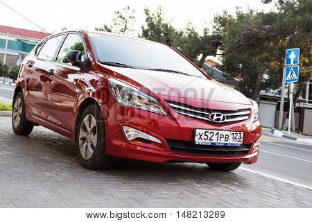 SOCHI RUSSIA - APRIL 29 2016: Red Hyundai Solaris parked on the streets of Sochi. New korean car.