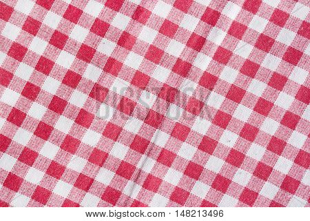 Red and white checkered picnic tablecloth. Red picnic tablecloth background.