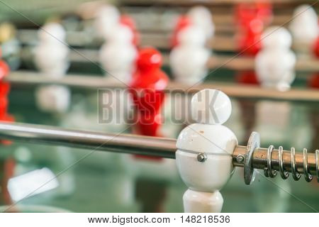 Football table game with red and white player