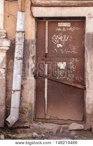 old locked door in the ramshackle old house