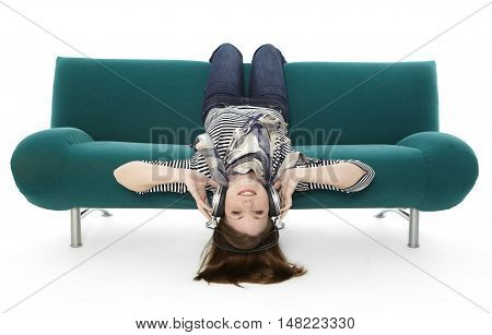Woman listening to music on a sofa with white background