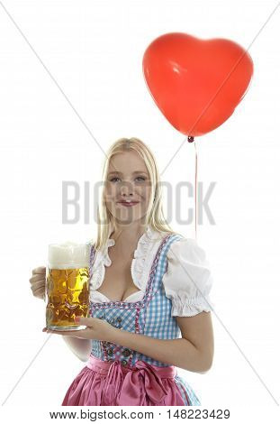 Woman in Dirndl with Balloon in front of white background