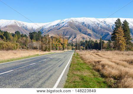 Straight road  to the  mountainous, Canterbury region, South Island, New Zealand.