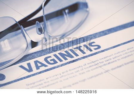 Vaginitis - Medical Concept with Blurred Text and Pair of Spectacles on Blue Background. Selective Focus. 3D Rendering.