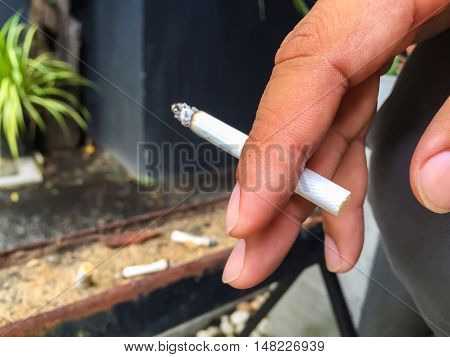 man smoking a cigarette, tobacco, danger, nicotine