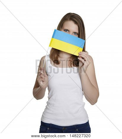 Attractive woman hides her face behind flag of Ukraine in front of white background