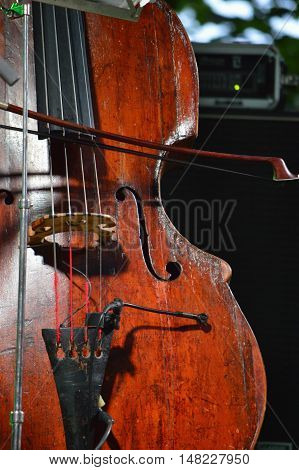 Old restored wooden jazz contrabass on stage
