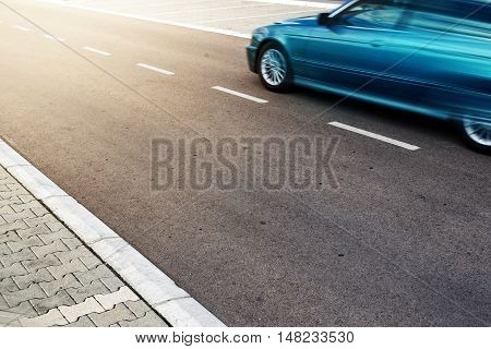 Car on the open road heading toward sunlight motion blur effect