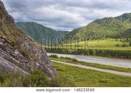 Summer Landscape: Mountain River Flowing along Little Canyon with Green Forest