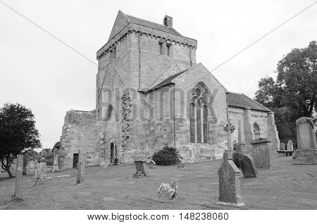 A view across a graveyard at Crichton collegiate church