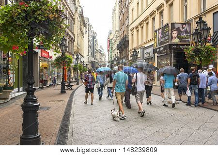 BUDAPEST, SEPTEMBER 17: Vaci street with tourists on September 17, 2016 in Budapest, Hungary. On Vaci street in Budapest has collected a huge number of shops, boutiques, cafes and restaurants.