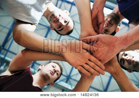 basket ball players team portrait in hi-school sport gym