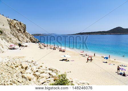 TURKEY KAPUTAS BEACH - MAY 29: Tourists on famous Kaputas beach near Kas city on May 29 2016 in Turkey