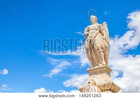 San Rafael Archangel statue in the center of the popular Roman Bridge in Cordoba Andalusia Spain.