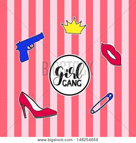 Set of fashion badges, stickers, pins and patches including girl gang quote, gun, crown, high heel shoe and red lips on striped background.