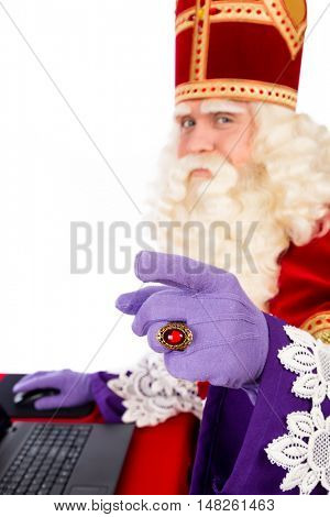Sinterklaas with laptop. isolated on white background. Dutch character of Santa Claus. selective focus