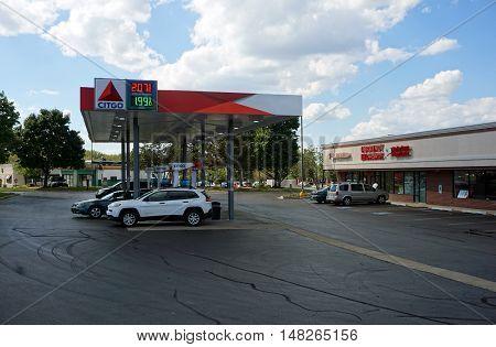 BOLINGBROOK, ILLINOIS / UNITED STATES - SEPTEMBER 17, 2016: People purchase gasoline at the Citgo gasoline station in Bolingbrook.