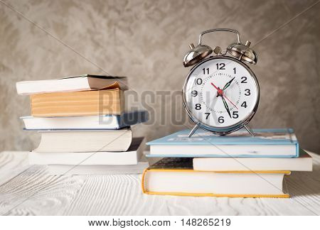 metal alarm clock time to study with books