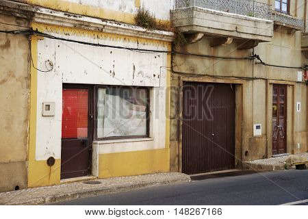 degraded front of house in a village in southern Portugal