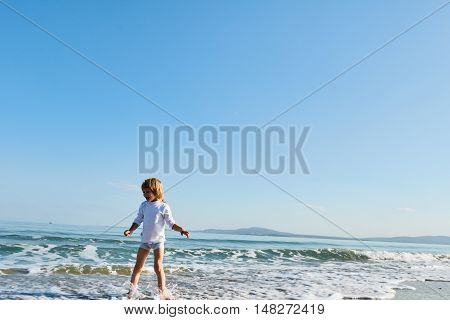 Smiling boy rejoice the sea. autumn outdoor
