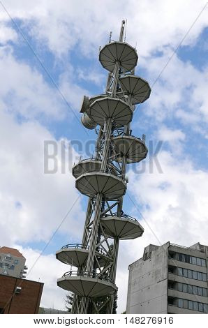 New Westminster, BC, Canada - August 22, 2016 : Telus telecommunications tower equipment and repeater antenna dishes