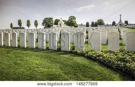 FLANDERS FIELDS, BELGIUM - MAY 12, 2016: One of about 800 cemeteries holding the remains of the casualties of WW1. The 100th anniversary of the end of the War will be in 2018.