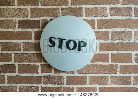 stop sign on the wall background. design