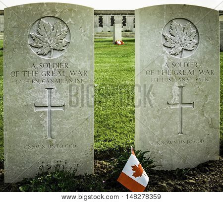 FLANDERS FIELDS, BELGIUM - MAY 12, 2016: Graves of two Canadian soldiers who died during the first World War. 2018 will mark the 100th anniversary of the War.