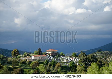 House and cemetery on the top of the hill Baltessiniko village. Arcadia PeloponneseGreece
