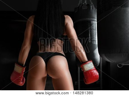 Dream butt. Cropped shot of a sexy sporty female posing wearing boxing gloves showing off her perfect buttocks