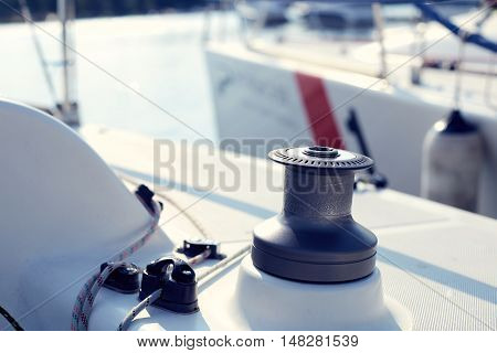 Grey winch on the white yacht without hawser or rope
