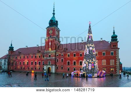 Royal Castle and Christmas Tree in City of Warsaw in Poland on evening during sleet.