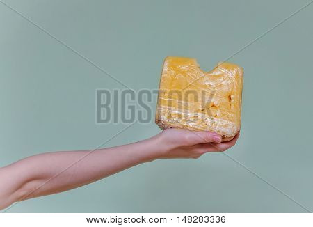 Arm  With A Piece Of Cheese