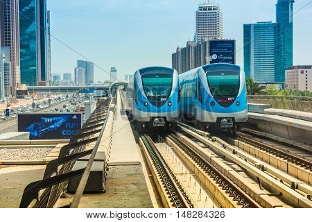 Dubai, United Arab Emirates - May 1, 2013: Dubai Metro the worlds longest fully automated metro network. Dubai Metro train along the Red Line.