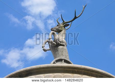 Top of the fountain with an deer, the armoval symbol of county Palffys, in Cerveny kamen castle, Slovakia.
